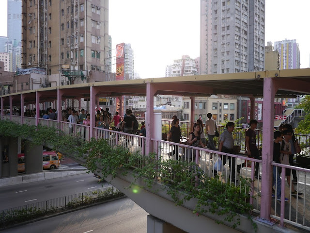 heavy foot traffic on an elevated walkway in Tsuen Wan, Hong Kong