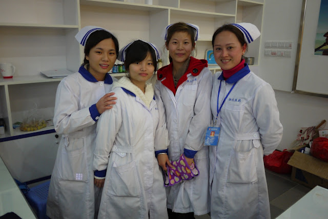 four woman working at a pharmacy in Putian, China