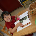 Our Montessori preschool students have access to many non-fiction books, and plenty of time to look at pictures and read the books.