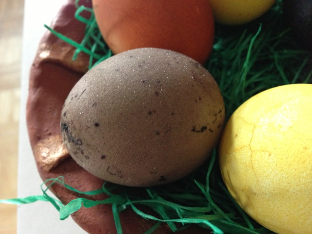 Egg colored with red wine has little sparkly crystals all over.