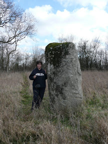 Brampton Standing Stone with Kat next to it to demonstrate the sheer size of this lump of rock