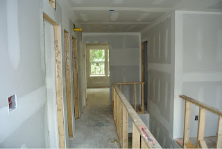 Picture of the upstairs hallway just after drywall installed