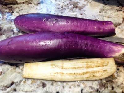 3 small chinese eggplants on a plate