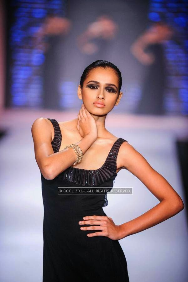 A model walks the ramp for Laksha Pahuja on Day 1 of India International Jewellery Week (IIJW), 2014, held at Grand Hyatt, in Mumbai.
