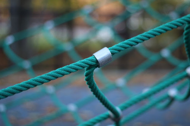 another playground webby structure in green rope