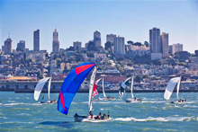 J/120s sailing one-design down San Francisco city front
