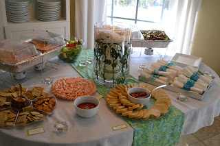 The spread at this appetizer table looks delicious.