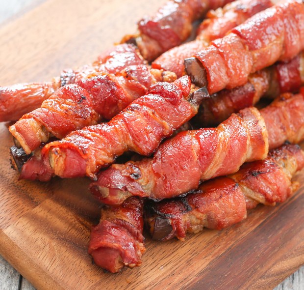 bacon-wrapped eggplant fries on a cutting board