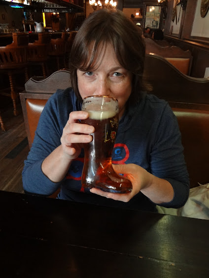 image of My Darling B drinking beer from a boot in a Milwaukee tavern