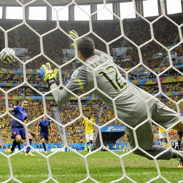 Brazil's goalkeeper Julio Cesar fails to stop a penalty kick by Netherlands' forward and captain Robin van Persie (L) during the third place play-off football match between Brazil and Netherlands during the 2014 FIFA World Cup at the National Stadium in Brasilia on July 12, 2014.