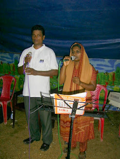 Pastor Sabu and his wife ministering together in Kerala