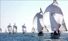 J/24 sailboats- sailing under spinnaker off Plymouth, England