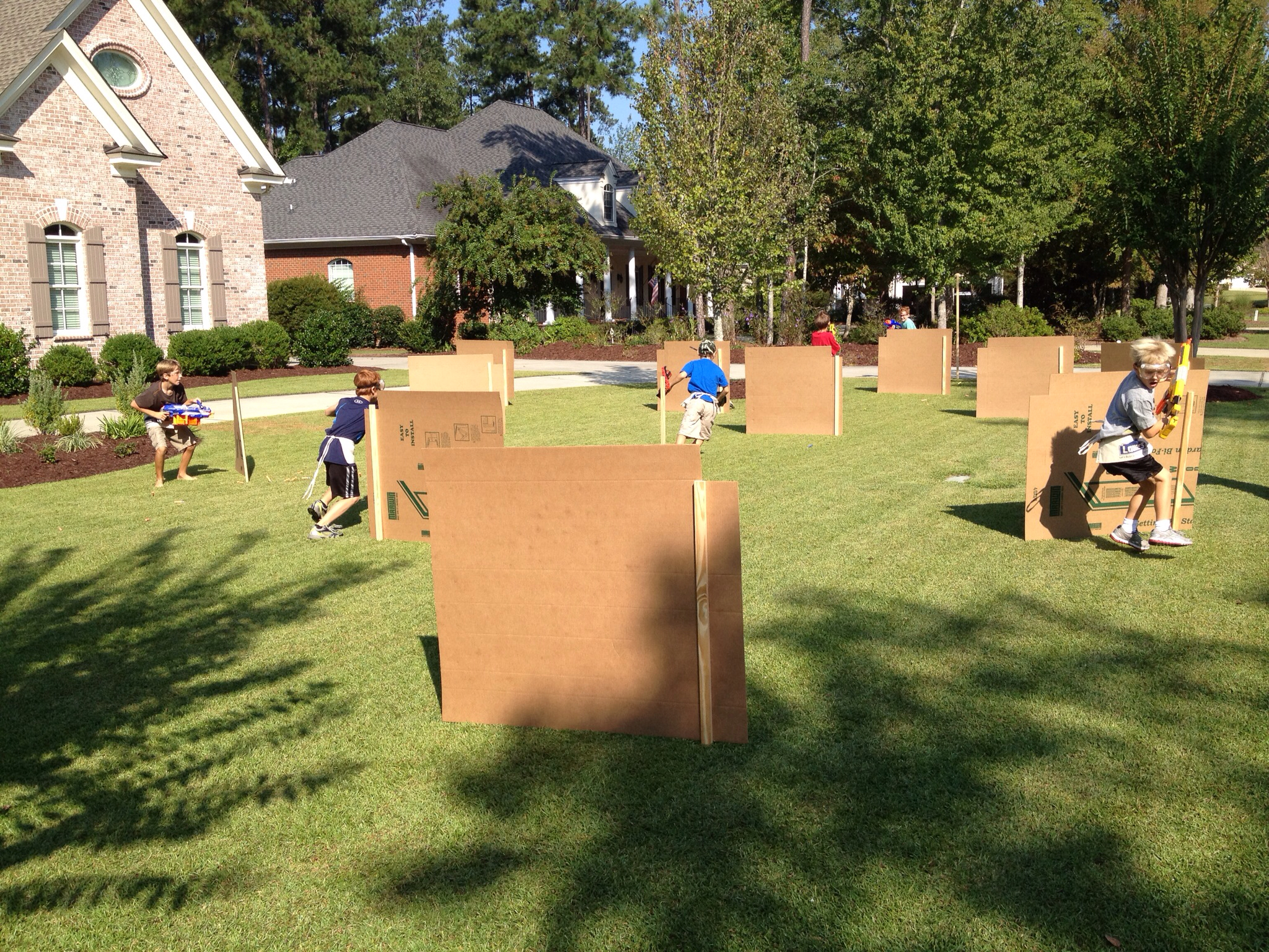 cardboard barricades supported by wooden stakes and a staple gun