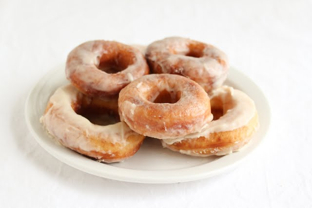 photo of donuts piled on a plate