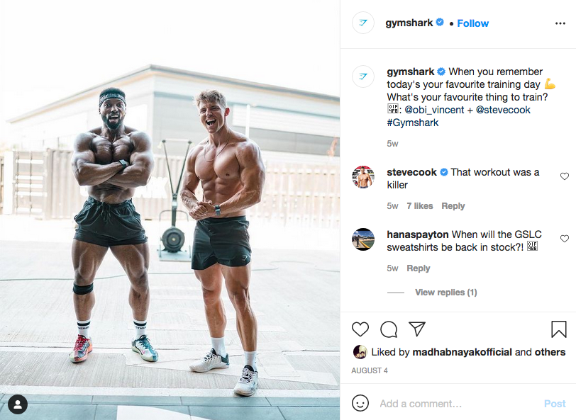 """Buzz example: Gym Shark's Instagram page showing Steve Cook and Obi Vincent flexing shirtless. Caption reads: """"When you remember today's your favourite training day. What's your favourite thing to train?"""""""