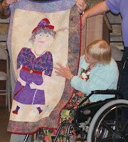 Mary Alma McAlister explains the details of  an award winning quilt to Walhalla High fellow Class of '60 members