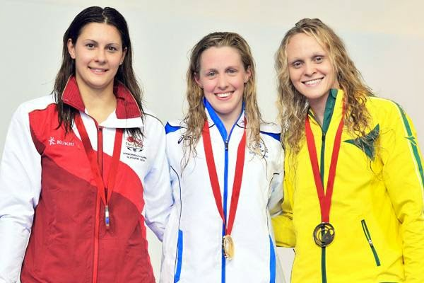 (L-R) Silver medallist England's Aimee Wilmott, gold medallist Scotland's Hannah Miley and Bronze Australia's Keryn McMaster pose on the podium for the Women's 400m individual medley medals ceremony at the Tollcross International Swimming Centre during the 2014 Commonwealth Games in Glasgow on July 24, 2014.