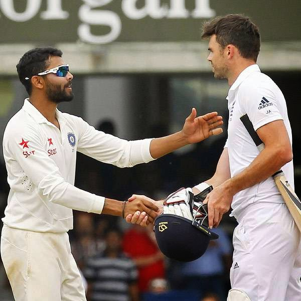 India's Ravindra Jadeja (L) shakes hands with England's James Anderson after India win the match by 95 runs on the fifth day of the second cricket Test match between England and India at Lord's cricket ground in London on July 21, 2014.