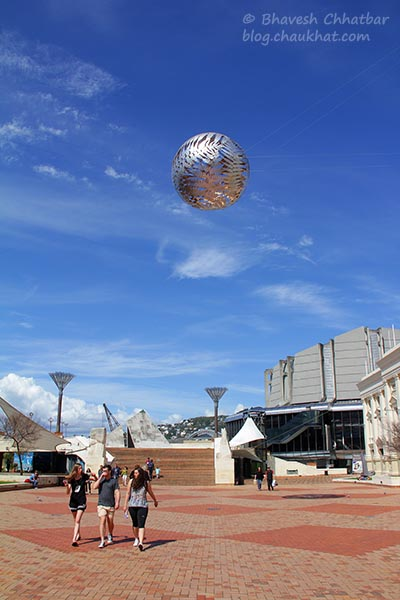People Walking Under the Silver Fern Ball at Civic Square, Welllington, New Zealand