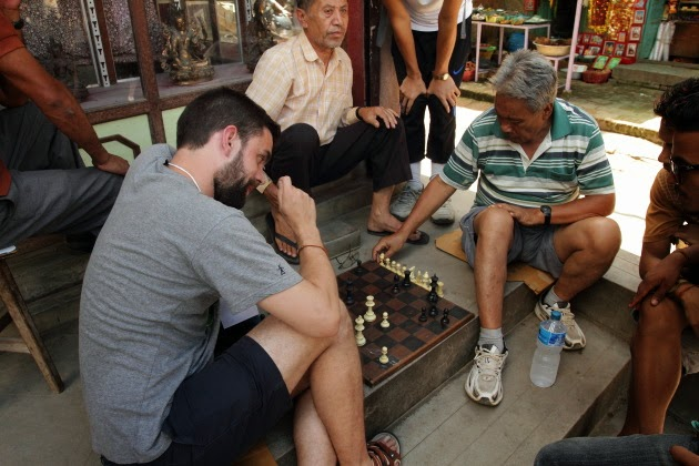 Game of chess between a Nepali local and a Spanish tourist at Patan