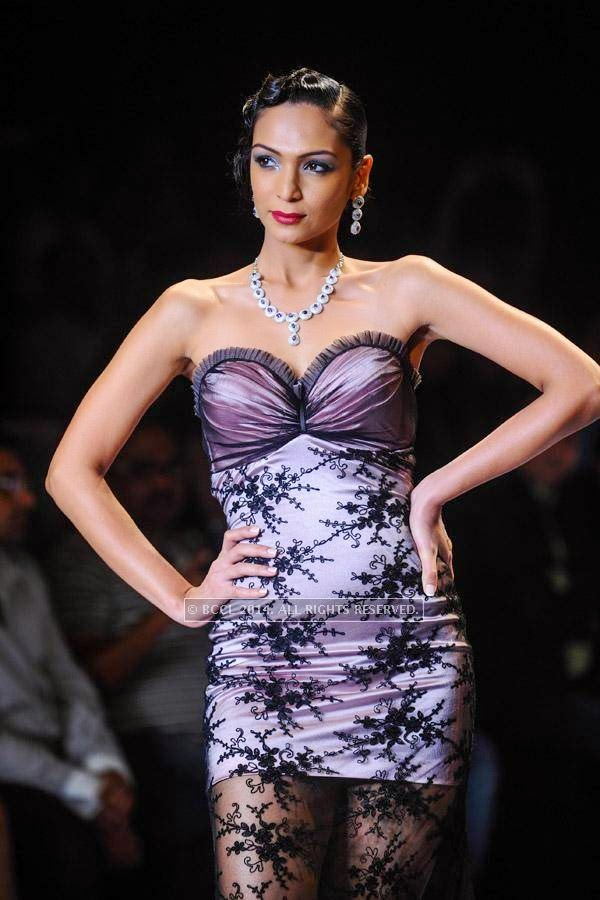 A model walks the ramp for Gitanjali on Day 2 of India International Jewellery Week (IIJW), 2014, held at Grand Hyatt, in Mumbai.