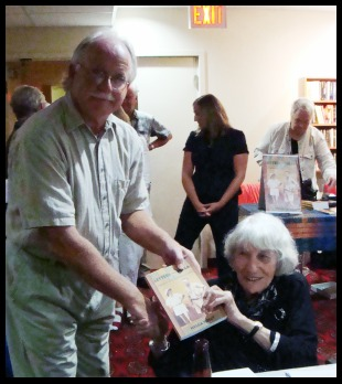 Publisher presents 1st copy to Helga