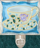 antique blue teacup and tiny blue flowers