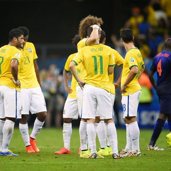 Brazil's players react at the end of the third place play-off football match between Brazil and Netherlands during the 2014 FIFA World Cup at the National Stadium in Brasilia on July 12, 2014.