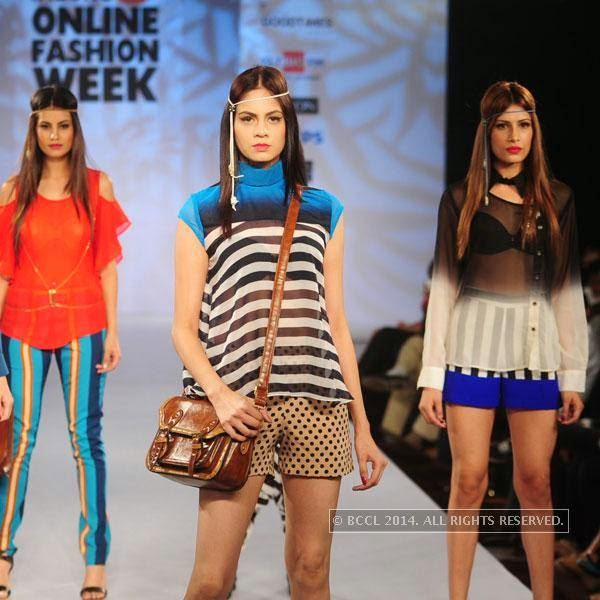 Models showcase creations during Jabong Online Fashion Week, held at Hotel Le Meridian, in Delhi, on July 30, 2014.