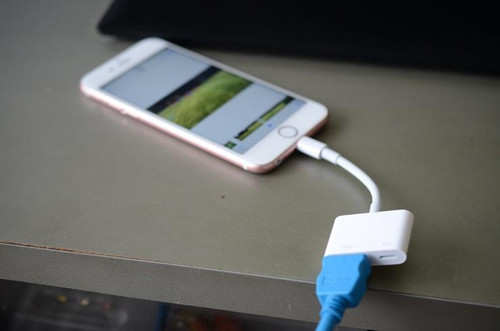 Plug the HDMI cable into the adapter inserted into your iPad or iPhone's Lightning connector