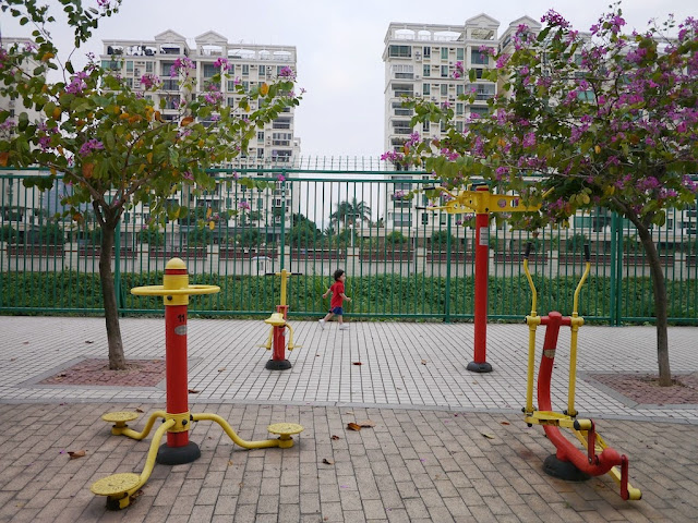 Public exercise equipment and a child running by