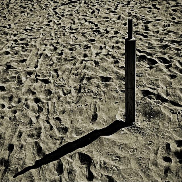 Astratto con palo e ombra