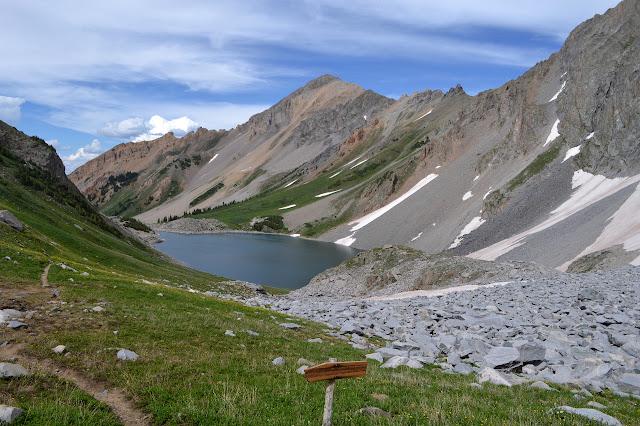 no campfires sign at the top and the lake