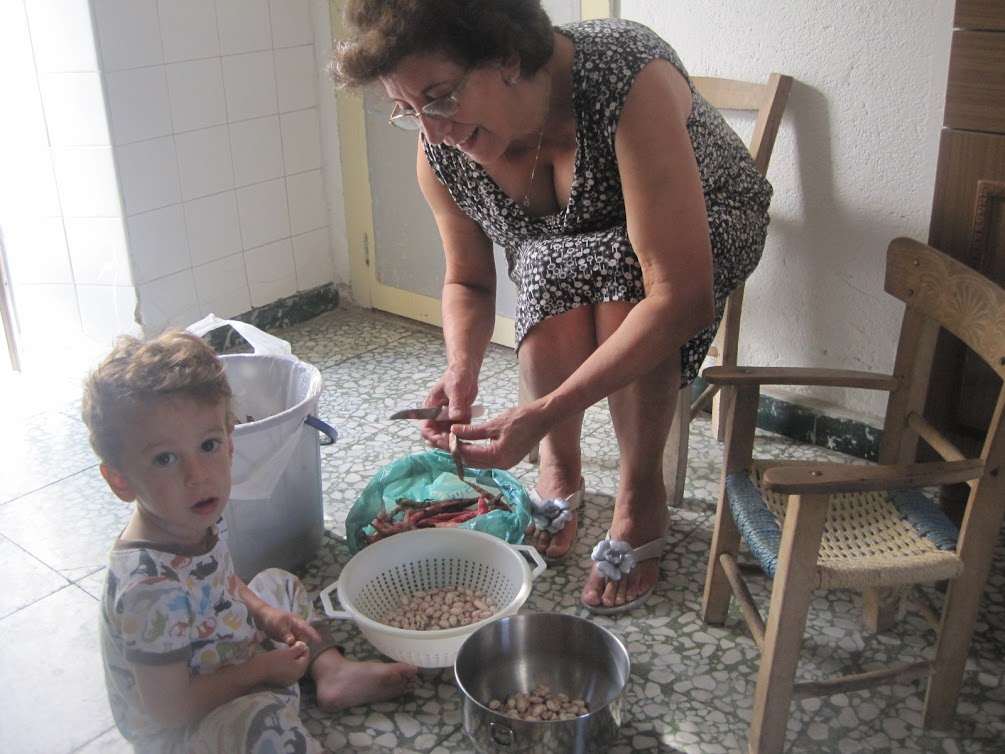My mother, Annunziata, shelling cranberry beans with our son.  We think our mother is aiming to pass our food tradition to our son.