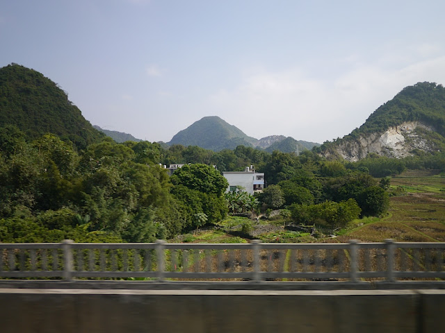 scenic view of mountains from train window while heading from Guangzhou to Changsha