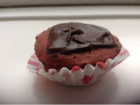 red velvet cupcake with chocolate topping in heart design paper case