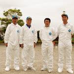 Yoh Kawano and colleagues in white radiation suits at Fukushima Japan