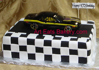Die cast Dodge Charger on Black and white checkered fondant men's custom birthday cake