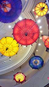 These umbrella lights move up and down in the atrium which houses the Parasol Down bar and lounge (Parasol Up is on the same level before you go down the curved escalator) at The Wynn, Las Vegas