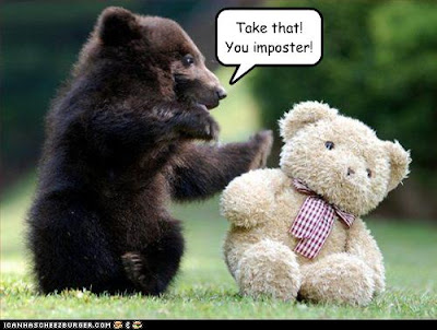 funny-pictures-bear-pummels-an-imposter.jpg