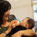LePort Preschool Huntington Beach -  - Teacher feeding infant at Montessori childcare