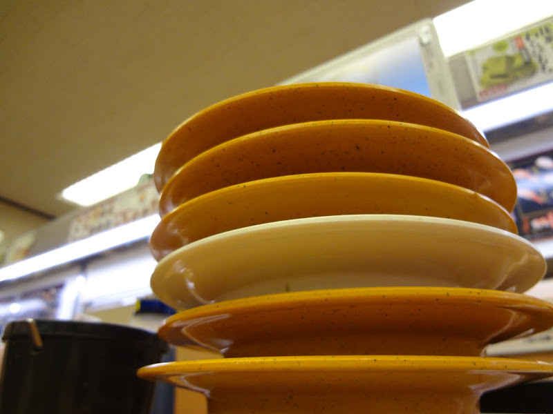 Sushi plates piled high