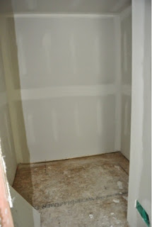 Picture of the master bedroom walk in closet with drywall installed