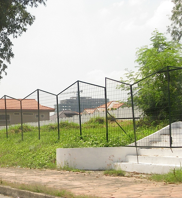 stairs leading to a fenced-in empty lot