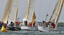 J/44s sailing around mark