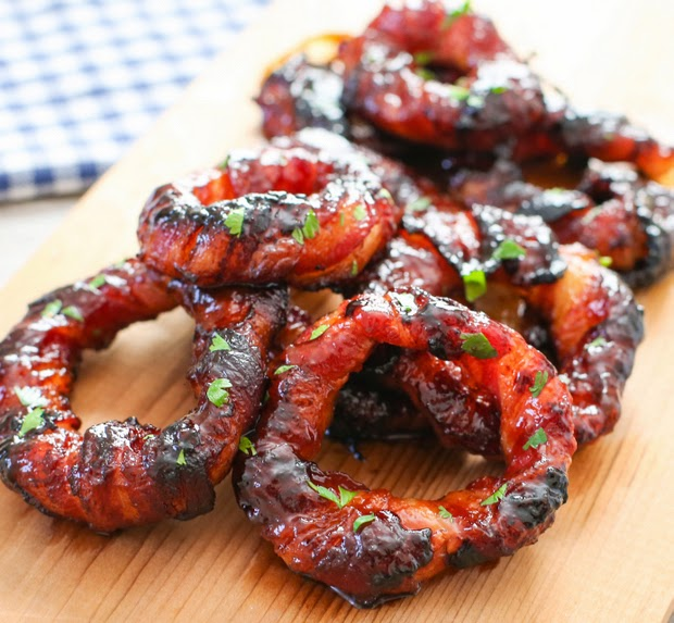 photo of Sriracha Bacon Wrapped Onion Rings on a cutting board