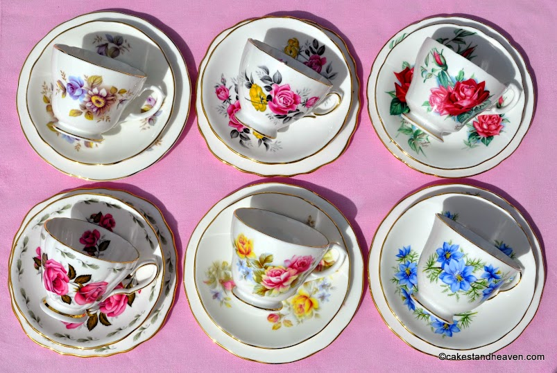 Mismatched floral teacups with beautiful garden flowers