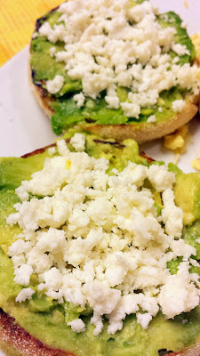 Avocado on toasted english muffin topped with queso fresco cheese