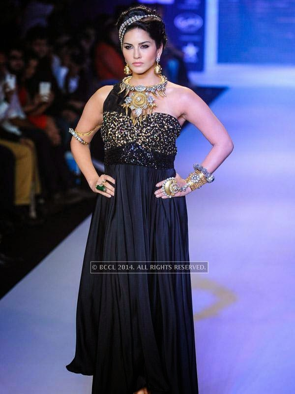 Bollywood's hot diva Sunny Leone sizzles on the ramp as she showcases a design by Apala by Sumit on Day 1 of India International Jewellery Week (IIJW), 2014 at Grand Hyatt, Mumbai.
