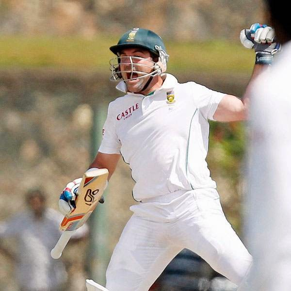 South Africa's Dean Elgar celebrates his century during the first day of their first test cricket match against Sri Lanka in Galle July 16, 2014.